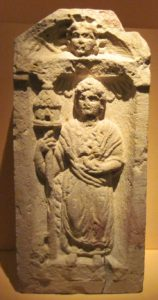 A depiction of Nantosuelta from Speyer, showing her distinctive sceptre and birds. The head of Sol can be seen in the tympanum.